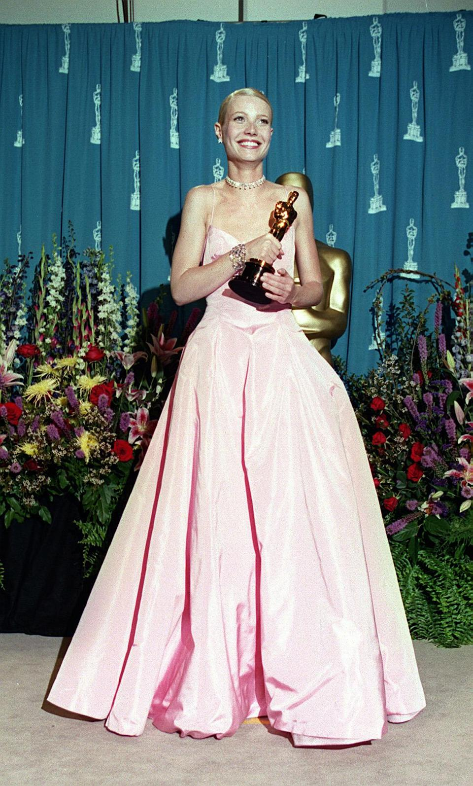<p>The dress that divided the nation in 1999. Was Gwyneth's pink Ralph Lauren dress a sweet, appropriate dress for a young actress picking up her first Oscar, or an ill-fitting, wrinkled prom queen nightmare? The debate rages on. (Photo: PA) </p>