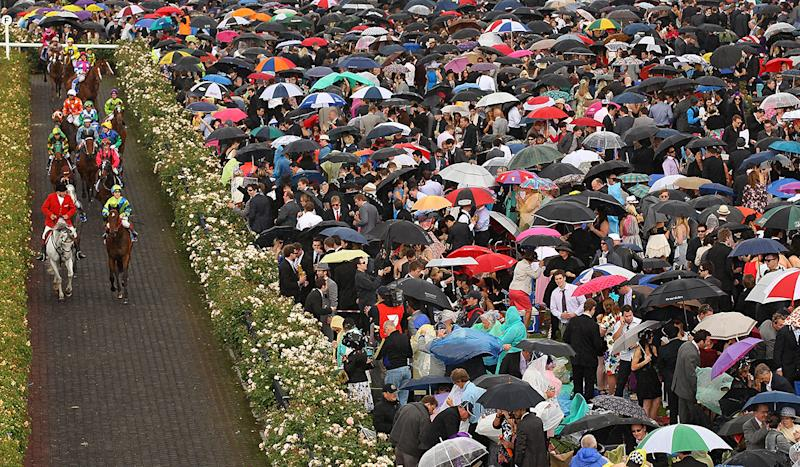 Melbourne Cup 2018: Flemington punters end up a wet mess