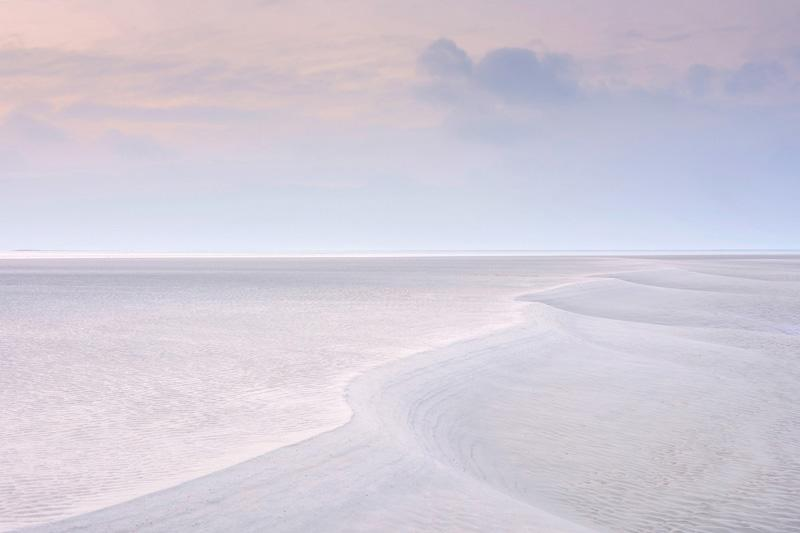 <p>Diminutive Dune, Sand forms at low tide, West Wittering, West Sussex, England. Mr Graham said: 'As well as its minimal simplicity, I particularly like the indeterminate scale of the image. The double S-curve could be two metres long or two thousand… It was actually about twenty'<br />(Benjamin Graham/Landscape Photographer of the Year 2017) </p>