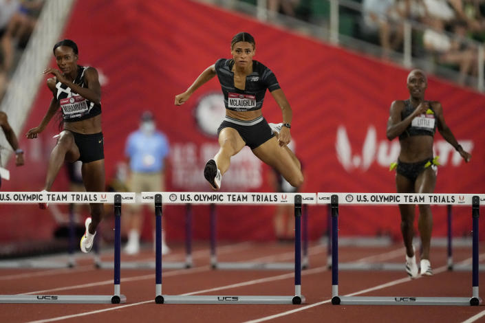 FILE - In this June 27, 2021, file photo, Sydney McLaughlin sets a new world record in the finals of the women's 400-meter hurdles at the U.S. Olympic Track and Field Trials in Eugene, Ore. One of the most entertaining races at the upcoming Tokyo Games figures to be the women's 400 hurdles, where McLaughlin set a new world record by edging Dalilah Muhammad at the U.S. track trials. (AP Photo/Ashley Landis, File)