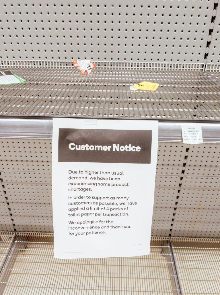 Pictured is a sign in an Australian supermarket informing customers they are experiencing product shortages.