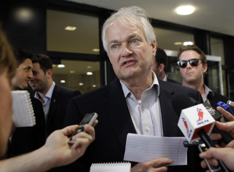 Donald Fehr, executive director of the NHL Players Association, speaks to reporters about on going labor talks with the league outside the NHL headquarters in New York, Tuesday, July 31, 2012. The current collective bargaining agreement ends on Sept. 15, and the NHL season is scheduled to open on Oct. 11. Detroit Red Wings Dan Cleary listens, right.(AP Photo/Kathy Willens)