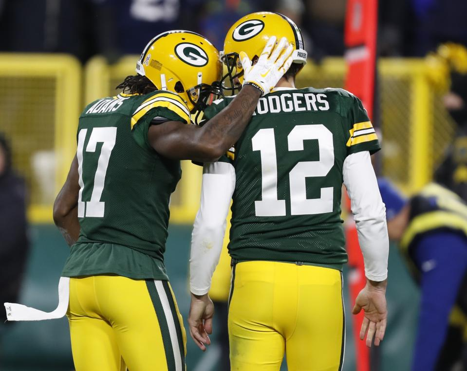 Green Bay Packers' Davante Adams celebrates his touchdown catch with Aaron Rodgers during the second half of an NFL football game against the Miami Dolphins Sunday, Nov. 11, 2018, in Green Bay, Wis. (AP Photo/Matt Ludtke)