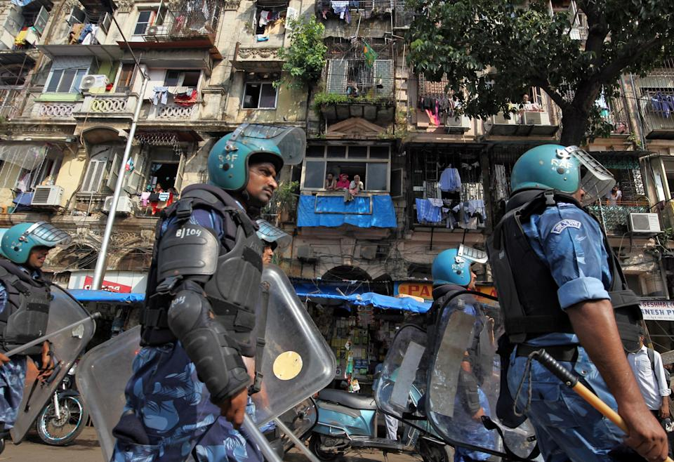 Rapid Action Force (RAF) personnel patrol in a residential area before Supreme Court's verdict on a disputed religious site in Ayodhya, in Mumbai, India November 9, 2019. REUTERS/Prashant Waydande