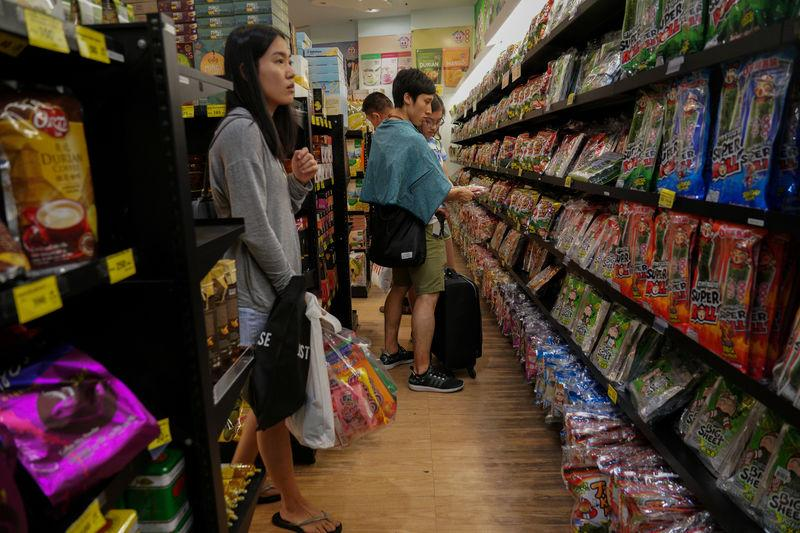 Tourists shop inside a Taokaenoi Land shop at a department store in Bangkok