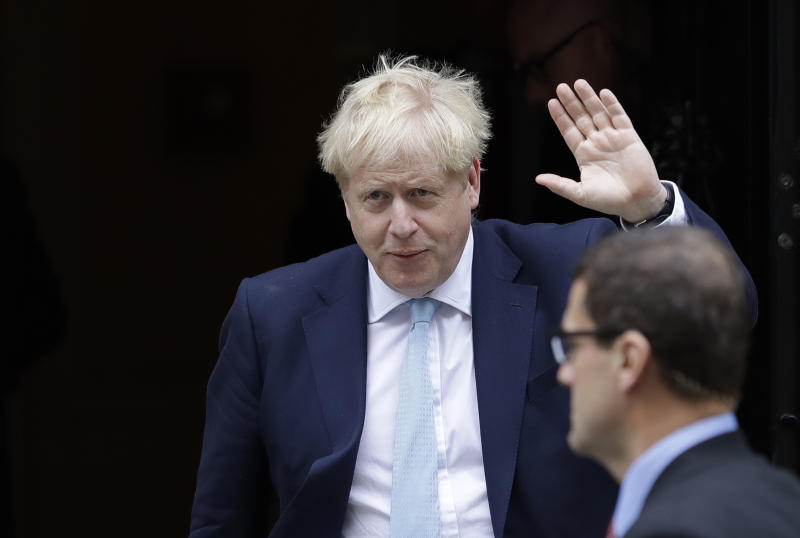 "Britain's Prime Minister Boris Johnson leaves Downing Street to attend Parliament in London, Thursday, Oct. 3, 2019. The U.K. offered the European Union a proposed last-minute Brexit deal on Wednesday that it said represents a realistic compromise for both sides, as British Prime Minister Boris Johnson urged the bloc to hold ""rapid negotiations towards a solution"" after years of wrangling.(AP Photo/Kirsty Wigglesworth)"