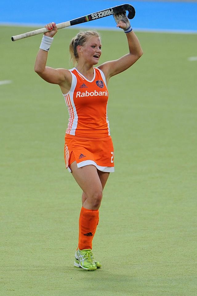 MOENCHENGLADBACH, GERMANY - AUGUST 25: Sophie Polkamp of Netherlands celebrates after winning the Women's Eurohockey 2011 semi final match between Netherlands and England at Warsteiner HockeyPark on August 25, 2011 in Moenchengladbach, Germany. (Photo by Dennis Grombkowski/Bongarts/Getty Images)