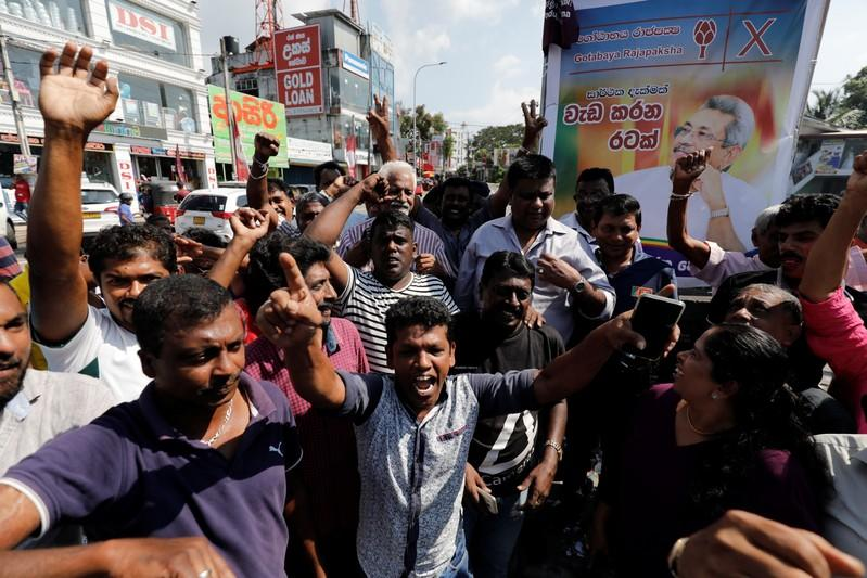 Supporters of Sri Lanka People's Front party presidential election candidate Gotabaya Rajapaksa celebrate after he won the presidential election in Colombo