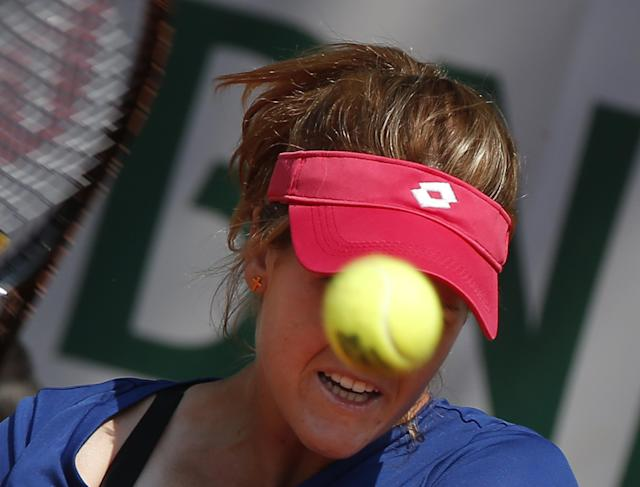 Spain's Maria-Teresa Torro-Flor returns the ball during the third round match of the French Open tennis tournament against Romania's Simona Halep at the Roland Garros stadium, in Paris, France, Saturday, May 31, 2014. (AP Photo/Michel Euler)