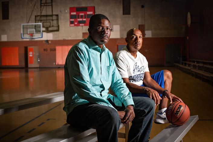 """Derrick Cooper, left, president of the L.A City Wildcats, and Tony Thomas, basketball coach at Compton High, both mentored Semaj Miller. <span class=""""copyright"""">(Jason Armond / Los Angeles Times)</span>"""