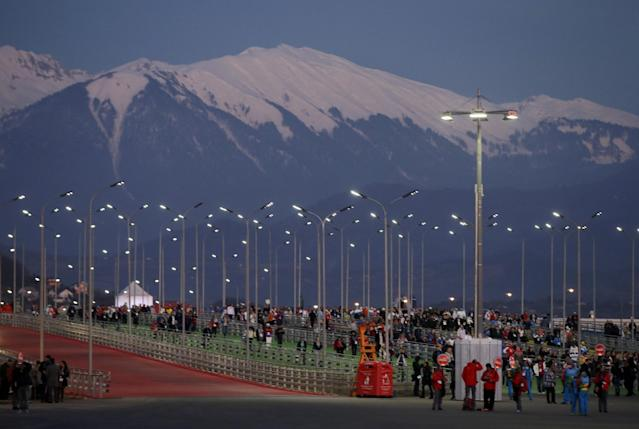 Fans make their way to Fisht Stadium for the opening ceremony of the 2014 Winter Olympics in Sochi, Russia, Friday, Feb. 7, 2014. (AP Photo/Darron Cummings)