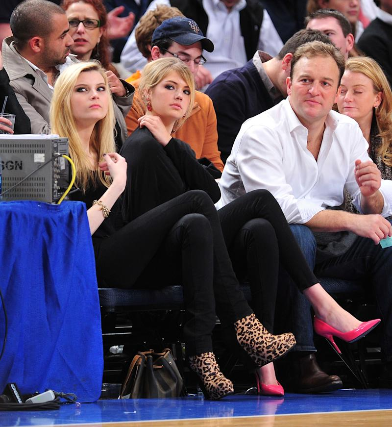 Kate Upton's bright pink pumps stood out at a New Jersey Nets vs the New York Knicks game at Madison Square Garden. Fortunately, her seatmate also got the memo about fancy footwear.