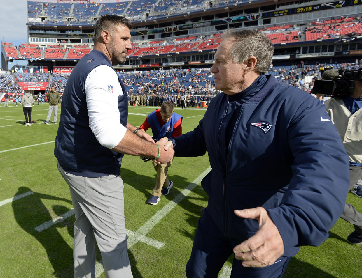 Tennessee Titans head coach Mike Vrabel, left, greets New England Patriots head coach Bill Belichick before last week's game. (AP)