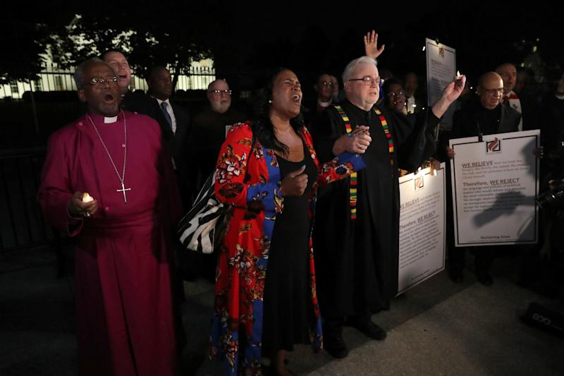 Episcopal Church Presiding Bishop Michael Curry (L) and Sojourners President and Founder Rev. Jim Wallis (R) lead fellow clergy in a vigil. (Jonathan Ernst / Reuters)