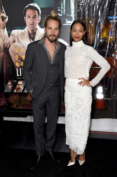 """Actress Zoe Saldana attend the premiere of Warner Bros. Pictures' """"Live By Night"""" with her husband, artist Marco Perego, at TCL Chinese Theatre in Hollywood, California, on January 9, 2017 (AFP Photo/Frazer Harrison)"""