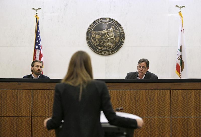 In this photo taken Monday, March 13, 2017, student Michelle Freeman, center, practices her argument in a moot courtroom at the University of California, Hastings College of the Law in San Francisco. Listening on the bench at left is Stephen Tollafield and at right is Gary Watt. The students will have the opportunity to argue at the 9th Circuit, the nation's largest federal appeals court, under an unusual program that offers law schools the opportunity to take on appeals. Over the course of a year, students spend countless hours researching their cases and writing briefs. The experience culminates in a 15-minute presentation before a judicial panel. (AP Photo/Eric Risberg)