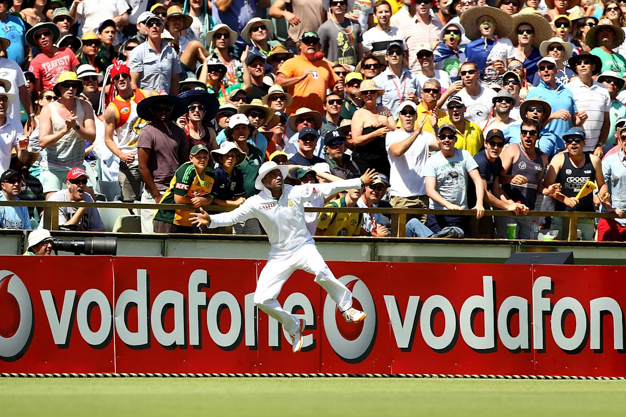 PERTH, AUSTRALIA - DECEMBER 01: Alviro Peterson of South Africa catches John Hastings of Australia on the boundary during day two of the Third Test Match between Australia and South Africa at WACA on December 1, 2012 in Perth, Australia.  (Photo by Paul Kane/Getty Images)