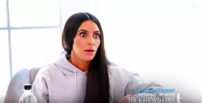 Kim Kardashian-West looks very surprised by the soon-to-be revealed news. Source: E!