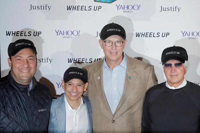 Kenny Dichter, Founder & CEO of Wheels Up, stands with jockey Mike Smith, majority owner Elliott Walden, and trainer Bob Baffert, posing for a photograph after a news conference regarding the horse Justify and its chances of winning the Belmont Stakes and Triple Crown of Thoroughbred Racing later this week in New York, U.S., June 7, 2018. REUTERS/Lucas Jackson