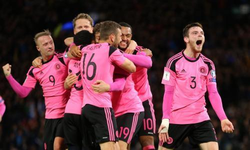 Scotland boost play-off hopes after own goal sinks 10-man Slovakia
