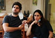 Tracy and Paul Najjar attend an interview with Reuters in Beirut