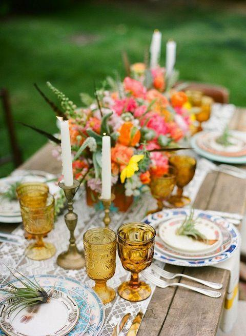 "<p>For a happy Thanksgiving spread that's energetic but still seasonally relevant, mix orange with pink. It'll feel even more rustic on a reclaimed wood table.</p><p>See more at <a href=""https://www.stylemepretty.com/2013/07/30/ojai-wedding-inspiration-from-bash-please-primary-petals-bryce-covey-photography/"" rel=""nofollow noopener"" target=""_blank"" data-ylk=""slk:Style Me Pretty"" class=""link rapid-noclick-resp"">Style Me Pretty</a>.</p>"