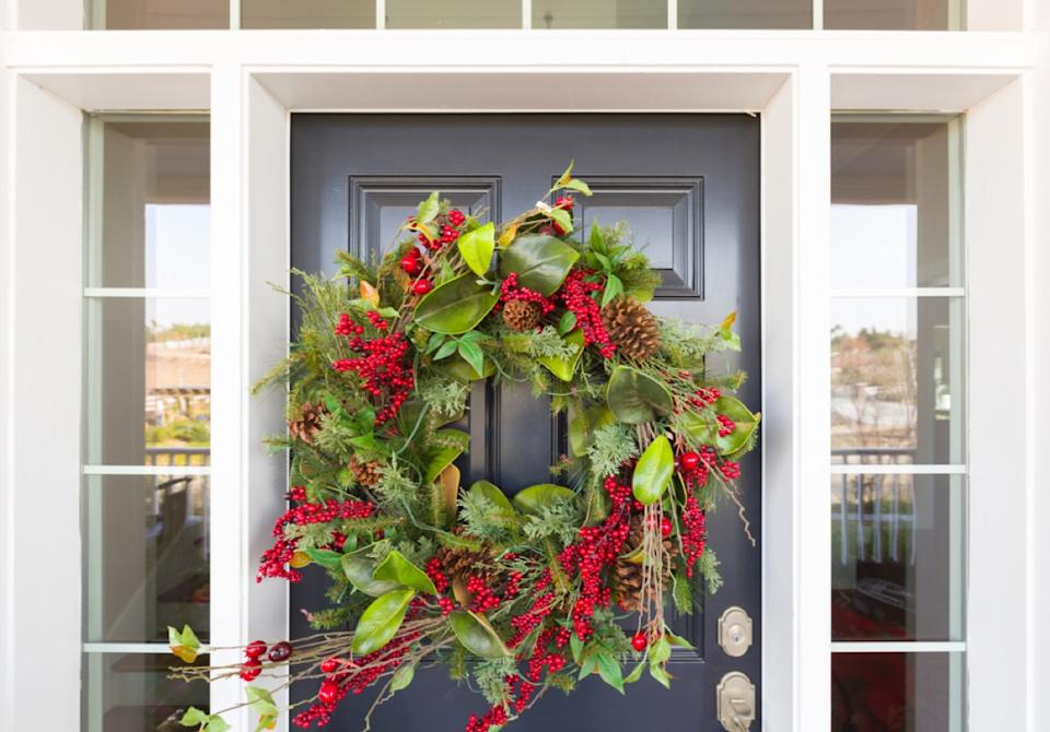 christmas wreath on black front door
