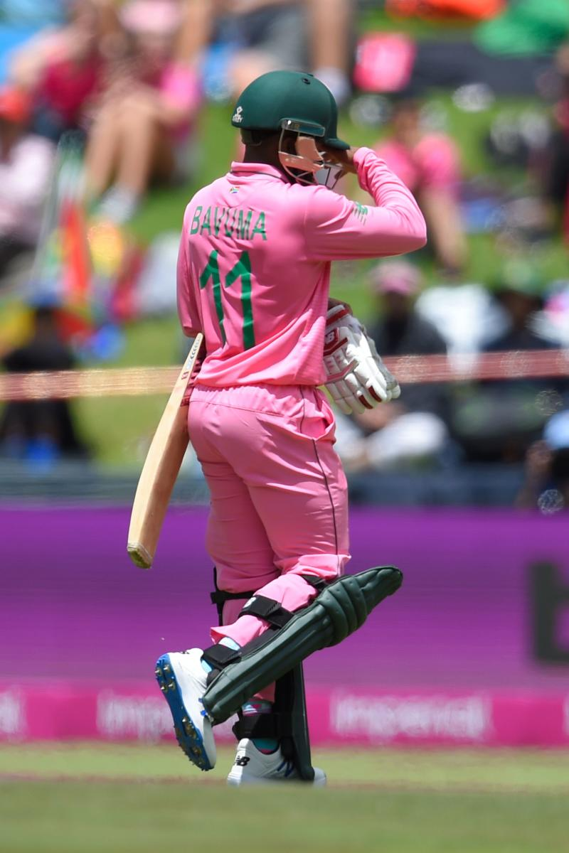 South Africa's Temba Bavuma walks back to the pavilion after his dismissal by England's Adil Rashid during the third one day international (ODI) cricket match between South Africa and England at the Wanderers Stadium in Johannesburg on February 9, 2020. - The South African team and the wickets are in pink to raise awareness for breast cancer. (Photo by Christiaan Kotze / AFP) (Photo by CHRISTIAAN KOTZE/AFP via Getty Images)