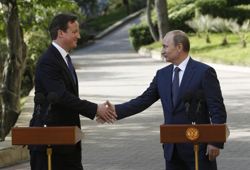 Russian President Vladimir Putin, right, and Britain's Prime Minister David Cameron shakes hands as they speak to the media, after their meeting in the Bocharov Ruchei residence in the Black Sea resort of Sochi, Russia, Friday, May 10, 2013. Britain's Prime Minister met with Russian President Vladimir Putin in the Black Sea resort of Sochi on Friday. David Cameron was expected to press for a political solution to end the continuing violence in Syria. (AP Photo/Sergei Karpukhin, Pool)