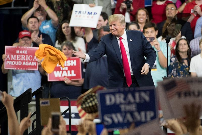 US President Donald Trump fires up his supporters at a campaign rally in Johnson City, Tennessee, as his Republican party girds for a Democratic wave in next month's midterm elections (AFP Photo/Sean Rayford)