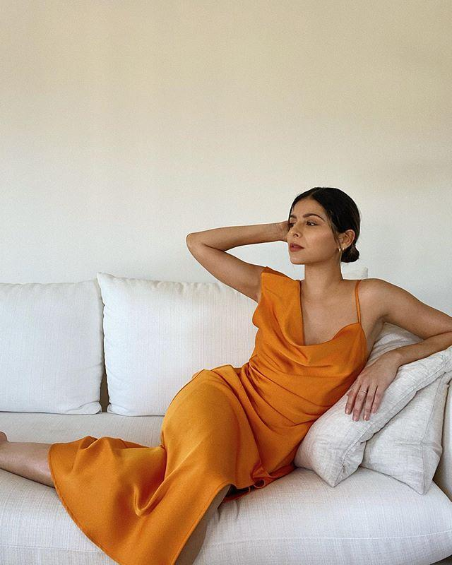 "<p>The Panamanian blogger currently resides in Los Angeles and her curated grid is definitely for fans of neutrals (this beautiful orange dress is an exception, okay?).</p><p><a href=""https://www.instagram.com/p/B_c7mz8lY2-"" rel=""nofollow noopener"" target=""_blank"" data-ylk=""slk:See the original post on Instagram"" class=""link rapid-noclick-resp"">See the original post on Instagram</a></p>"