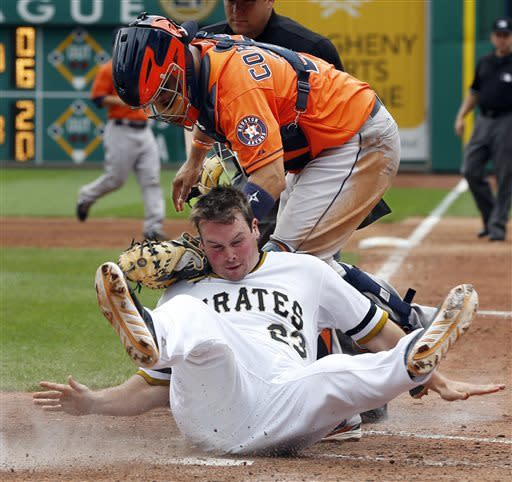 Pittsburgh Pirates' Travis Snider, bottom, rolls into Houston Astros catcher Jason Castro after being tagged out trying to score from second on a single by Gaby Sanchez in the sixth inning of a baseball game on Sunday, May 19, 2013, in Pittsburgh. (AP Photo/Keith Srakocic)