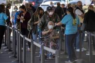 FILE PHOTO: People wait in line to be vaccinated in California