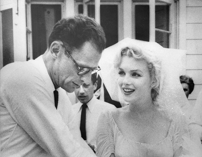 <p>Marilyn Monroe's third marriage was more traditional than her second. The Hollywood star wore a white sundress and a tulle veil when she married playwright Arthur Miller on June 29, 1956. </p>