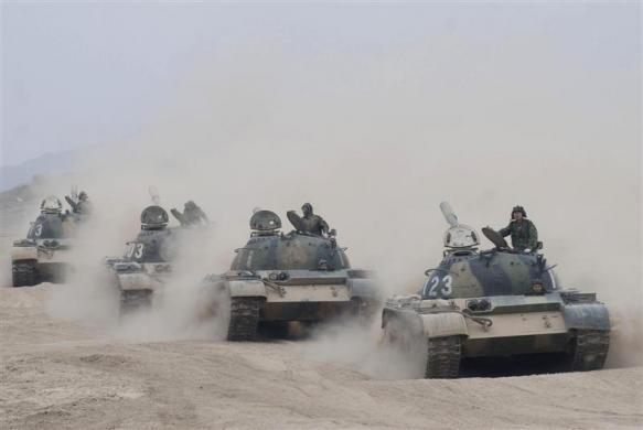 People's Liberation Army (PLA) tanks take part in a training session at an army base in Shanxi province April 8, 2008.