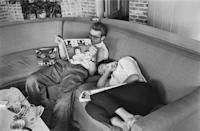 <p>Dean and Taylor are photographed relaxing while on the set of <em>Giant</em>. If you look closely, you can see Taylor on the cover of the magazine Dean is reading.  </p>