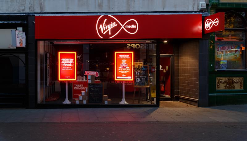 Nottingham, England - August 30, 2016: Frontage of the Virgin Media store at night on Clumber Street. In Nottingham, England. On 30th August 2016.