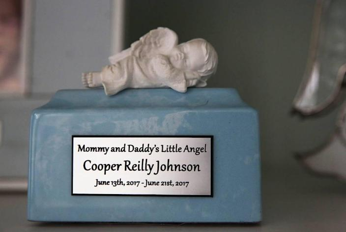 A porcelain sleeping cherub — inscription: 'Mommy and Daddy's Little Angel' — is a constant reminder of Cooper.