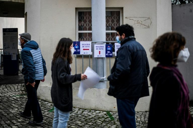 Voters queued outside polling stations in the capital Lisbon, being let in one by one under social distancing rules