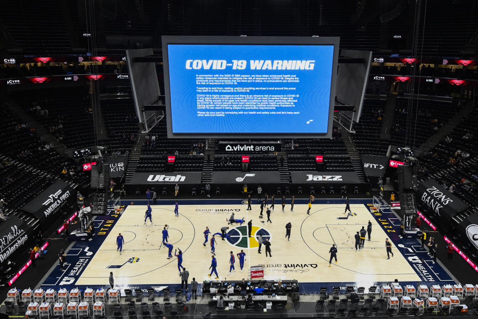 A COVID-19 warning is displayed over the floor before a game between the Utah Jazz and New York Knicks at Vivint Smart Home Arena earlier this season. (Alex Goodlett/Getty Images)