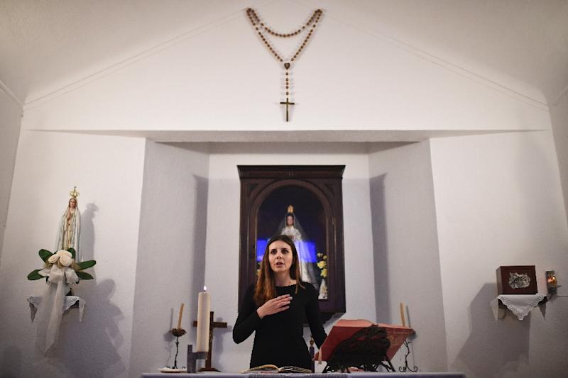Social worker Claudia Rocha is one of a number of women to lead services in churches in Portugal because of a shortage of Catholic priests (AFP Photo/PATRICIA DE MELO MOREIRA)