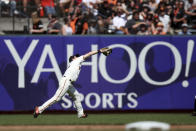 San Francisco Giants' Mike Yastrzemski catches a fly ball hit by Philadelphia Phillies' J.T. Realmuto during the eighth inning of a baseball game in San Francisco, Saturday, Aug. 10, 2019. (AP Photo/Scot Tucker)