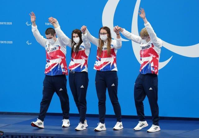 Great Britain's Reece Dunn (left), Bethany Firth, Jessica-Jane Applegate and Jordan Catchpole celebrate after winning gold during the mixed 4x100m freestyle - S14