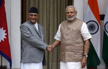 Nepal's Prime Minister Khadga Prasad Sharma Oli (L) shakes hands with his Indian counterpart Narendra Modi during a photo opportunity ahead of their meeting at Hyderabad House in New Delhi, India, February 20, 2016. REUTERS/Adnan Abidi