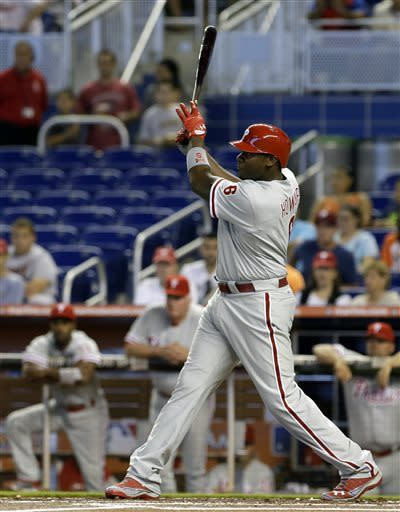 Philadelphia Phillies' Ryan Howard follows through on a base hit against the Miami Marlins during the first inning of a baseball game in Miami, Sunday, April 14, 2013. (AP Photo/Alan Diaz)