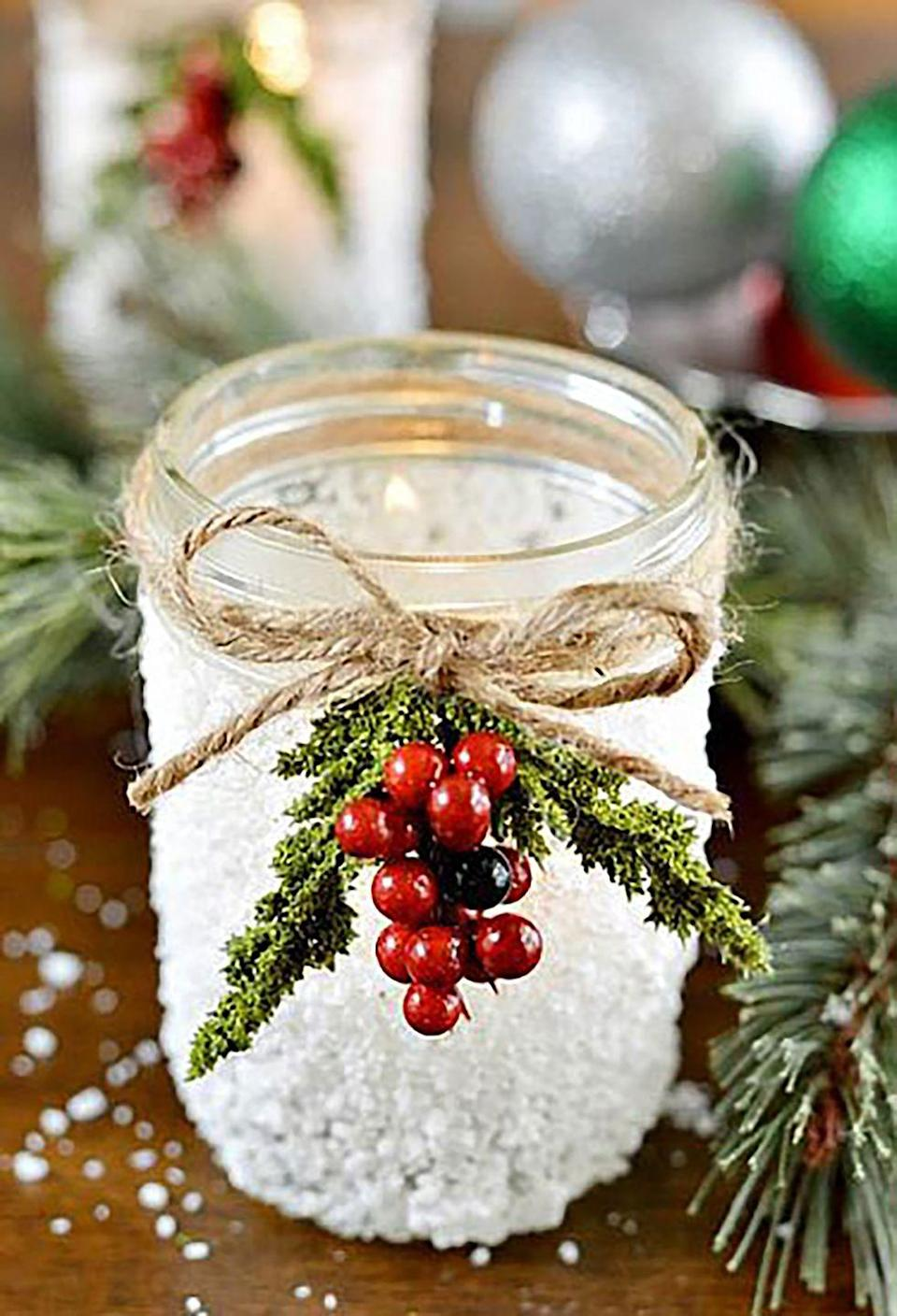 """<p>Align several of these handmade votives—tied with berries and twine—in the center of your dining table to create an elegant centerpiece. </p><p><strong>Get the tutorial at <a href=""""http://www.decoart.com/blog/project/89/snowy_mason_jar"""" rel=""""nofollow noopener"""" target=""""_blank"""" data-ylk=""""slk:DecoArt"""" class=""""link rapid-noclick-resp"""">DecoArt</a>.</strong></p><p><a class=""""link rapid-noclick-resp"""" href=""""https://www.amazon.com/TIAMALL-Natural-Twine-String-Packing/dp/B01HEPXEE2/?tag=syn-yahoo-20&ascsubtag=%5Bartid%7C10050.g.2132%5Bsrc%7Cyahoo-us"""" rel=""""nofollow noopener"""" target=""""_blank"""" data-ylk=""""slk:SHOP TWINE"""">SHOP TWINE</a></p>"""