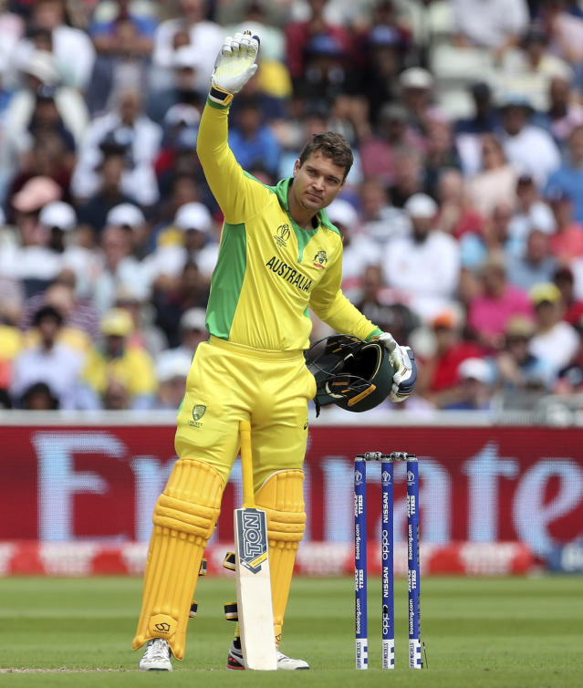 Australia's Alex Carey calls for medical help after he was hit off the bowling of England's Jofra Archer during the Cricket World Cup semi-final match between England and Australia at Edgbaston in Birmingham, England, Thursday, July 11, 2019. (AP Photo/Aijaz Rahi)