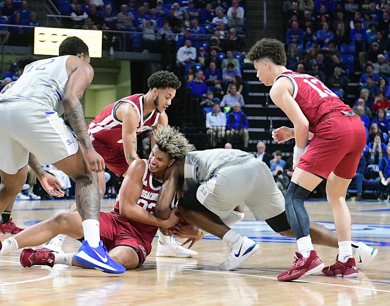 ST. LOUIS, MO. - JANUARY 05: Players fight for a loose ball during an Atlantic 10 Conference basketball game between the University of Massachusetts Minutemen and the Saint Louis Billikens on January 05, 2020, at Chaifetz Arena, St. Louis, Mo. Photo by Keith Gillett/Icon Sportswire via Getty Images)