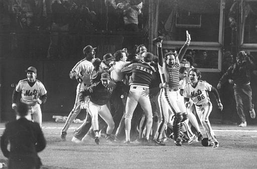 FILE - In this Oct. 25, 1986 file photo, the New York Mets celebrate a 6-5 victory over the Boston Red Sox in Game 6 of the World Series in New York.The Mets were down two runs with two out and nobody on against Boston in before rallying in the 10th inning for a 6-5 victory that pushed the series to a seventh game. (AP Photo/Richard Drew, File)