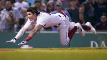 Boston Red Sox's Jarren Duran dives home to score, while advancing on an error after hitting an RBI triple, against the Toronto Blue Jays during the fourth inning of the second baseball game of a doubleheader at Fenway Park, Wednesday, July 28, 2021, in Boston. (AP Photo/Charles Krupa)